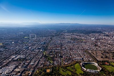 Aerial view of North Fitzroy with the Dandenong Ranges in the background in Melbourne, Victoria, Australia.