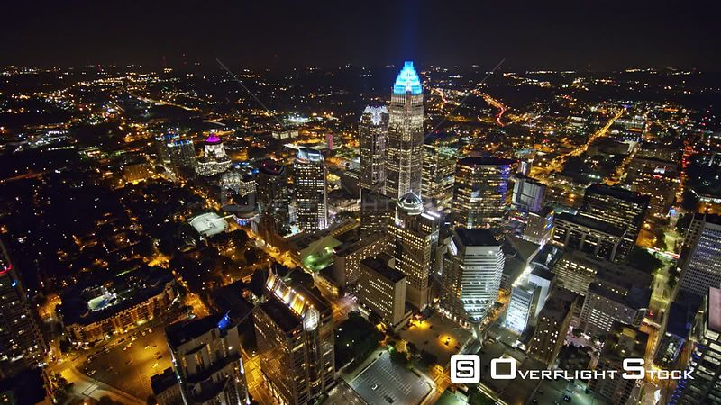 North Carolina Charlotte Aerial Birdseye panning cityscape view at night