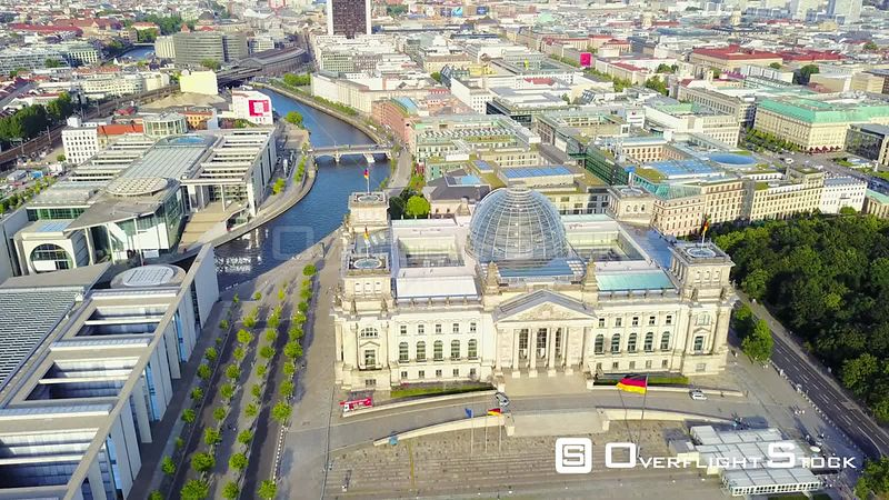 Germany Berlin Aerial Birdseye flying low around Reichstag building sunset cityscape