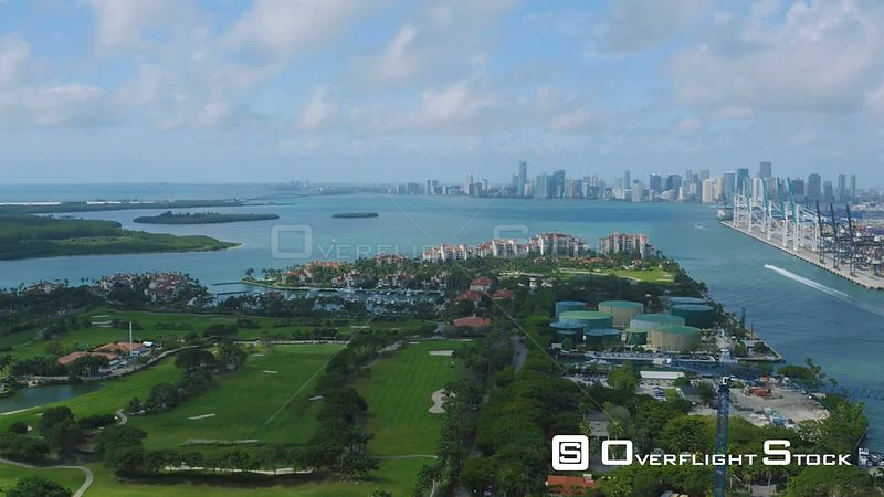 Miami Florida Flying over Fisher Island panning with cityscape and South Beach views.