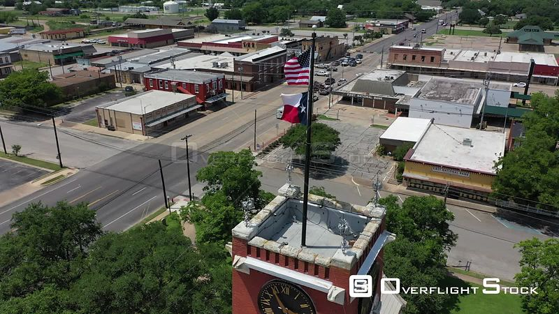 Flags, Clocktower, and Courthouse, Downtown, Giddings, Texas, USA