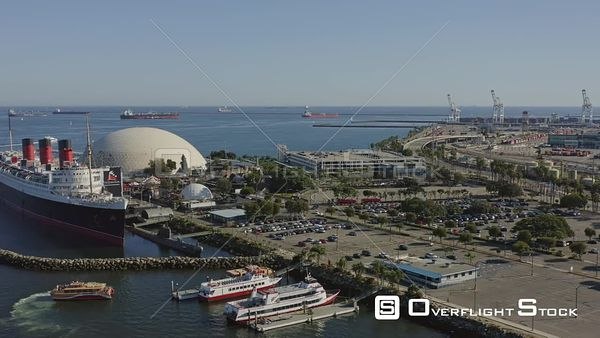 Long Beach CA Low panning view of cruise terminal and ocean liner museum with marina cityscape views