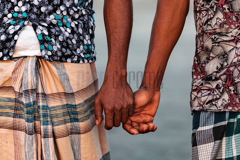 Men Holding Hands at the Cox's Bazaar Sea Beach