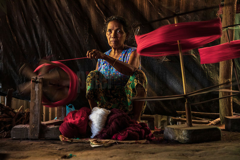 A Woman Formerly for Rakhine State Winds Hanks of Wool onto a Bobbin for Weaving