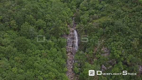 North Carolina Mountains Approaching, flying high looking over East Fork' Blue Ridge Upper Falls with seated couple with shor...