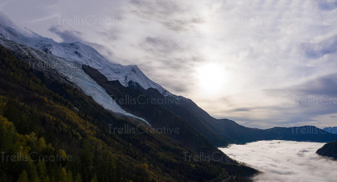 Panoramic view of the summit of Mont Blanc glacier and the fog covered valley of Chamonix