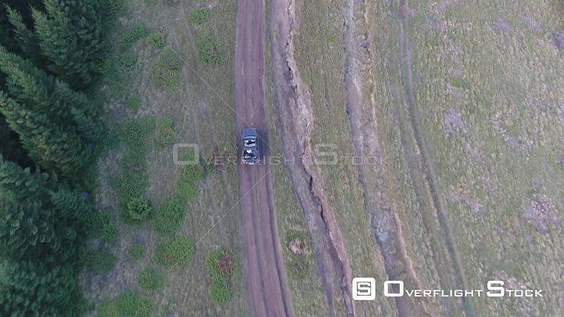 Offroad car driving on a dirt mountain road. Romania