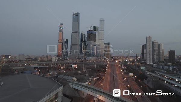 Sunset Fly Over the Main Road With Traffic and MBCC in View. Moscow Russia Drone Video View