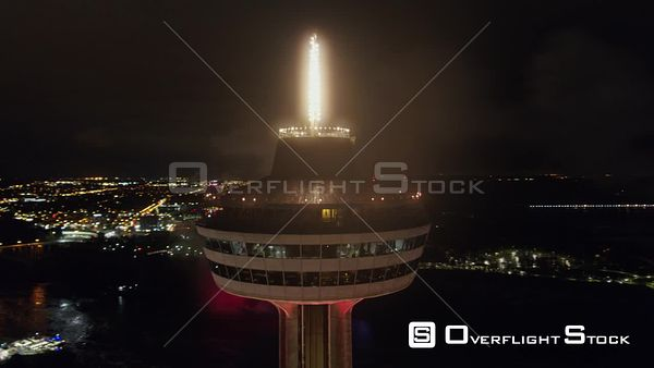 Niagara Falls Ontario Full nighttime panoramic of Skylon Tower close up with cityscape and Falls in background