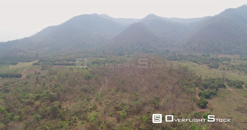 Thung Pi Thailand Aerial Flying around rural landscape near meditation sites