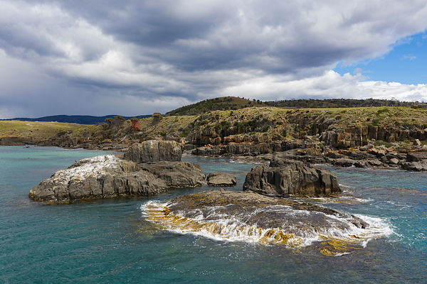 Aerial View of a Rocky Headland and Storm Clouds