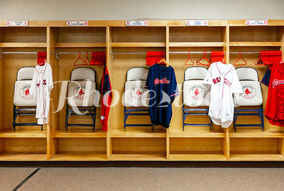 PawSox Baseball Uniforms and Folding Chairs in Team Locker Room Storage