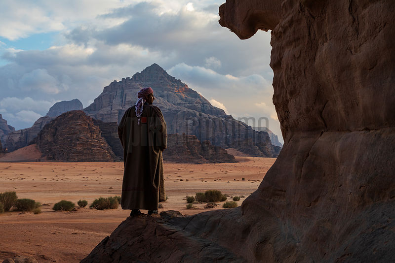 Bedhouin Watches the Sun Go Down at Wadi Rum