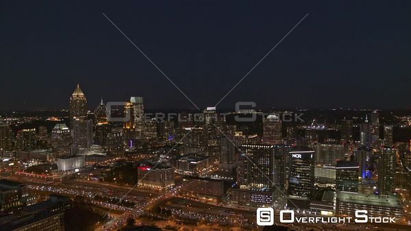 Atlanta Slow traveling panoramic of midtown cityscape with freeway traffic at night