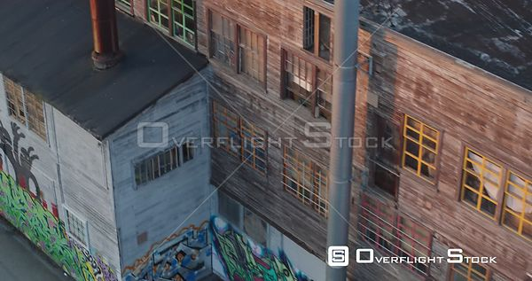 Old Wood Sided Warehouse with Graffiti at Sunset. Parker Street Studios, Vancouver, BC, Canada.