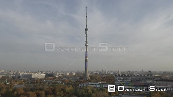 Moscow Teletower at Ostankino Approach Flight Over the Autumn Park. Moscow Russia Drone Video View