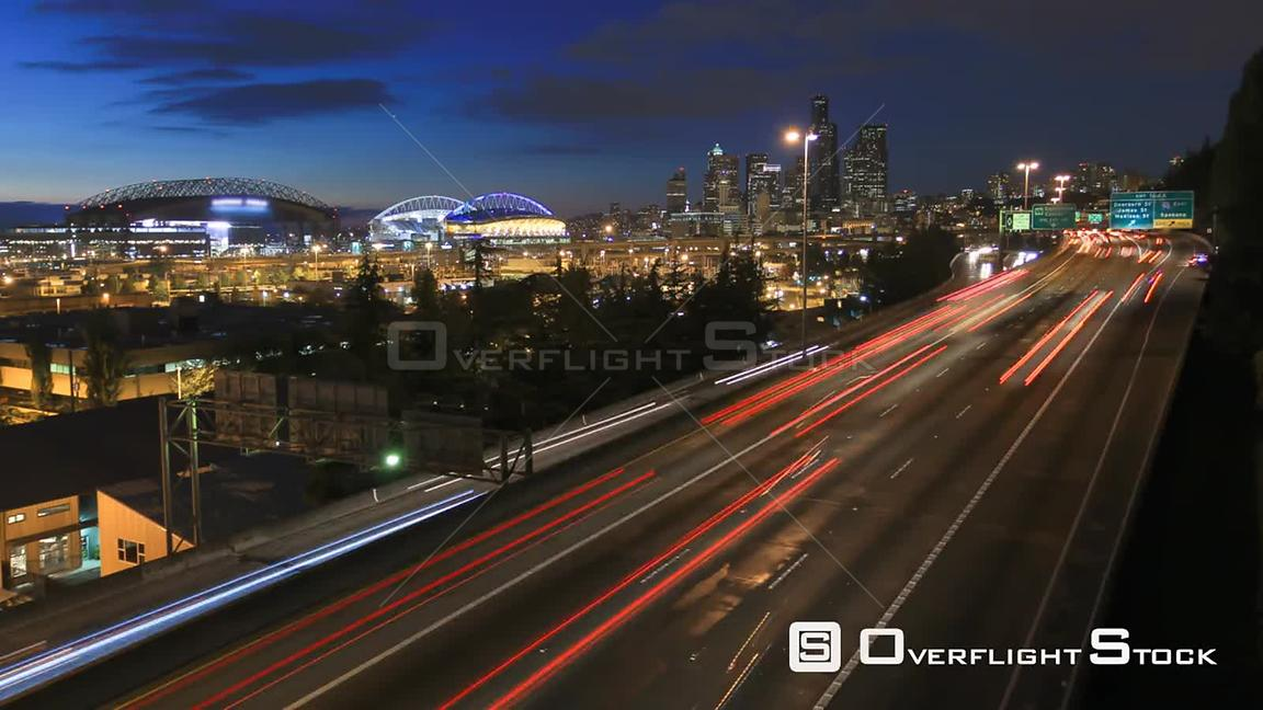 Seattle Washington State USA Seattle I5 traffic time lapse with cityscape in background at dusk.