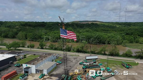 US Flag suspended from a crane in an industrial area, Dayton, Ohio, USA