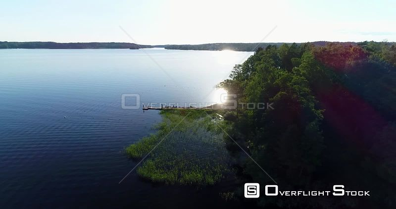 Reveal of a Small Beach With Bathing People in the Evening Sun, Sigtuna Sweden