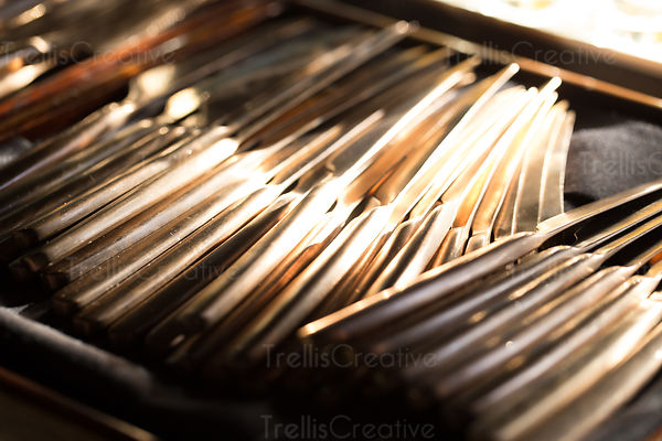 Close up of knives in a cutlery draw.