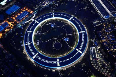 Aerial photograph of the Apple Inc Headquarters at night.