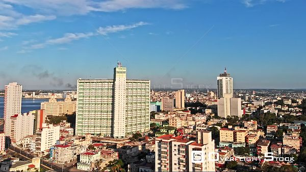 Cuba Havana Flying over water front cityscape with tall apartment building detail, birds