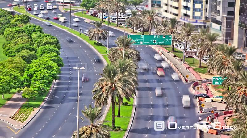 v27. Above time lapse shot of city traffic in Dubai using a photo effect.