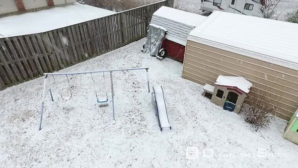 Backyard Playground Snowing in Suburban Neighbourhood Louisville Kentucky