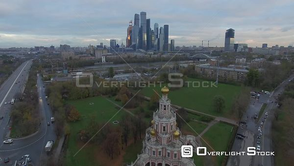 Sunset Fly Over Th Orthodox Church With Moscow Business City Center. Moscow Russia Drone Video View