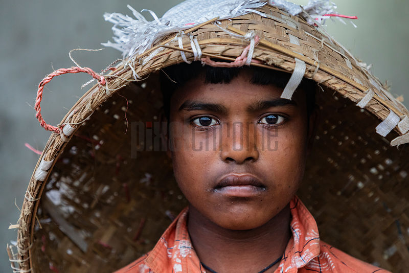 Young Boy with a Basket on Head at the Fiseri Ghat Fist Market