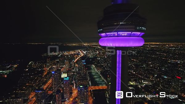 Toronto Ontario Nighttime multi view focus panning around CN Tower with cityscape backdrop