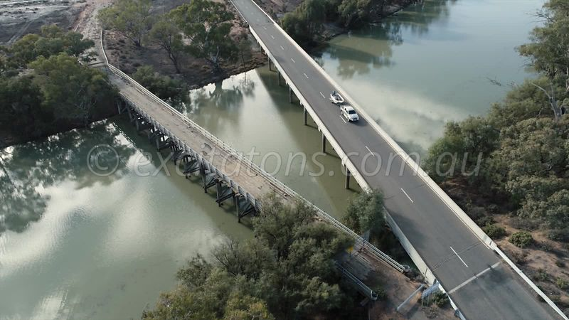 Aerial of a vehicle crossing a bridge over the Great Anabranch of the Darling.