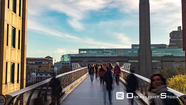 Time lapse view of people crossing the Millennium bridge in London with the Tate modern in the background