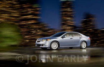 Silver-Blue Sporty Sedan Night Driving Action City Background