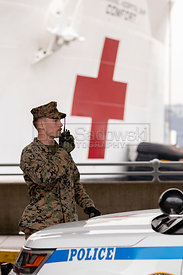 March 30. 2020 - New York, New York - Soldier at the site where the 1,000-bed floating hospital USNS Comfort, docked Monday a...