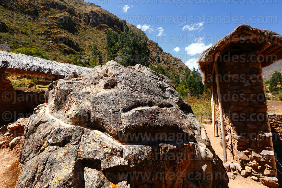 Water channel carved around side of large boulder or huaca at Inca site of Urco / Urqo, near Calca, Cusco Region, Peru