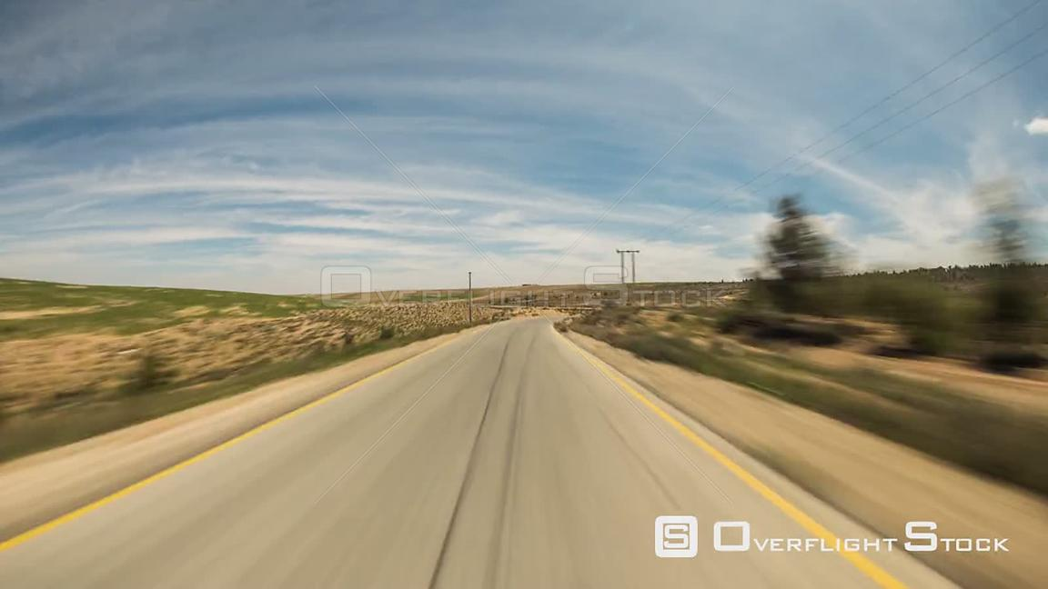 Driving time lapse through Jordan countryside and small towns
