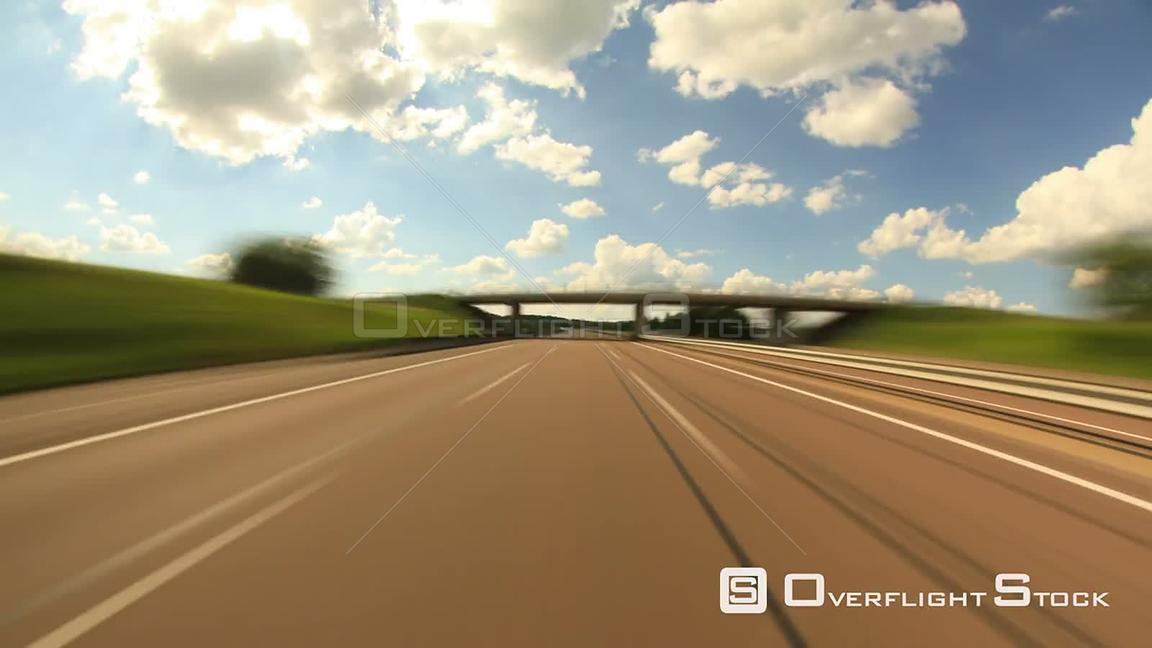 Scenic rear view highway driving time lapse clip in France.
