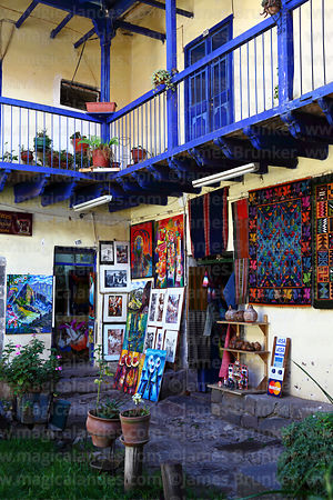 Paintings for sale in courtyard of typical colonial building, Cusco, Peru