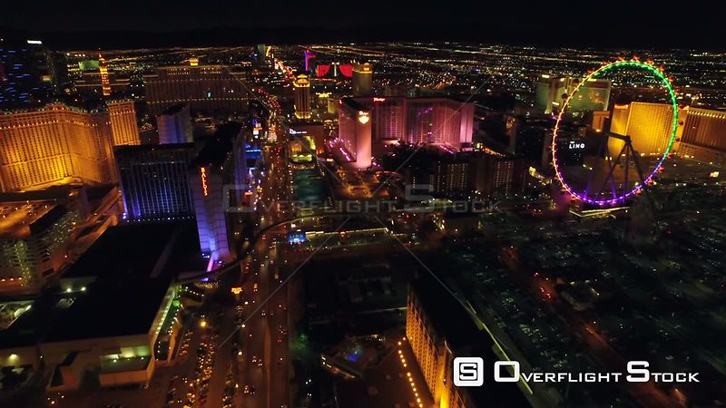Low flying backwards aerial with strip view. Las Vegas Nevada