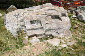 Carved stone altars in boulder at Inca site of Intinqala, Copacabana, Bolivia