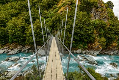 Rob Roy glacier hike swing bridge over the Matukituki River.