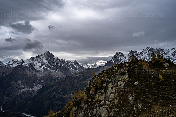Climbers in the distance reach a mountain peak in the French Alps