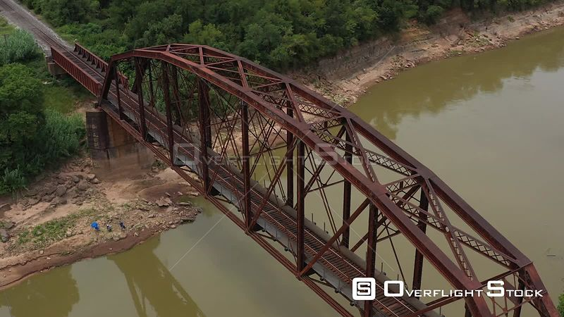 Rusty railroad bridge over a river, Brazos County, Texas, USA