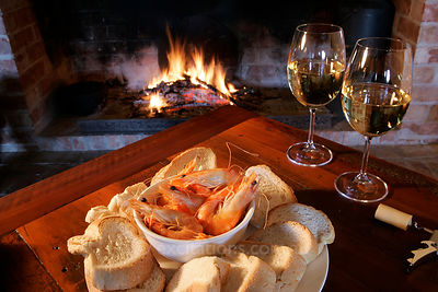 Bread, prawns, wine and open fire.