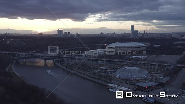 Late Sunset Forward Flight Over the Moscow River, With Luzniki Stadium. Moscow Russia Drone Video View