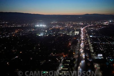 Aerial photogaph at dusk of traffic on the 101