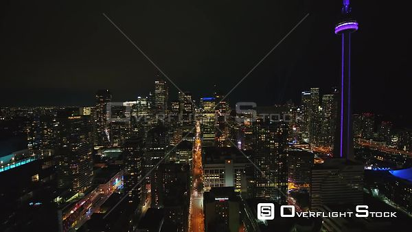 Toronto Ontario Fly through downtown cityscape at night following path of Wellington St west