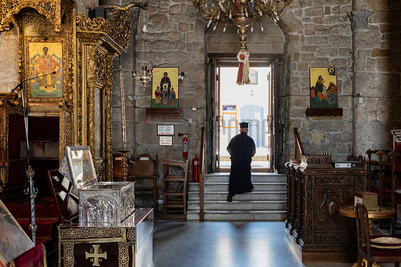 A Greek Orthodox Priest Leaves the Church of St Lazarus