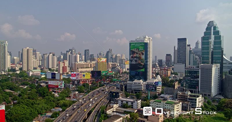 Thailand Bangkok Aerial Panning from expressway and billboards to cityscape